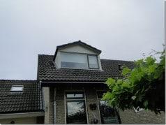 Rolgordijn dakkapel wit buitenaanzicht
