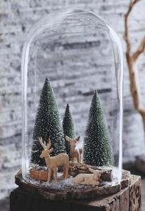 Kerststolp met kerstboompjes en rendieren