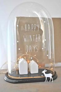 kerststolp met huisjes en verlichting